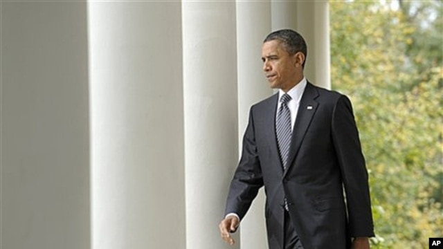 President Obama walks to the Rose Garden of the White House to discuss the death of former Libyan leader Moammar Gadhafi, Oct. 20, 2011.