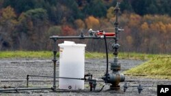 FILE - The well head for a gas well is seen Oct. 14, 2011, in Dimock, Pennsylvania, where regulators blame faulty gas wells for leaking methane into the groundwater.