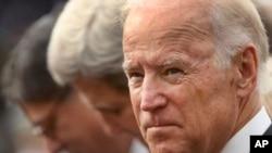 FILE - From right to left, Vice President Joe Biden, Secretary of State John Kerry and Treasury Secretary Jacob Lew.