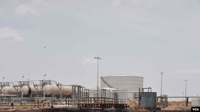 South Sudan shut down oil production in January, and claims sites such as this in Unity state that are surrounded by pockmarked earth are targets for Sudanese warplanes, April, 2012. (H. McNeish/VOA)