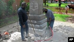 Workers begin removing a Confederate statue in Gainesville, Fla., Aug. 14, 2017. The statue is being returned to the local chapter of the United Daughters of the Confederacy, which erected the bronze statue in 1904.