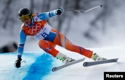 Norway's Kjetil Jansrud skis in the men's alpine skiing downhill race during the 2014 Sochi Winter Olympics at the Rosa Khutor Alpine Center, Feb. 9, 2014.