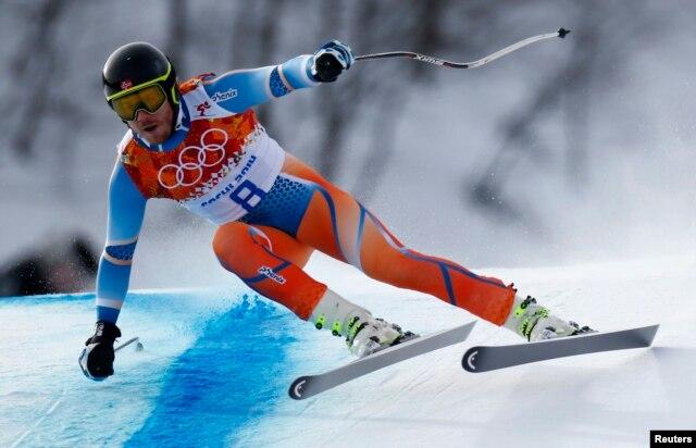 Norway's Kjetil Jansrud skis in the men's alpine skiing downhill race during the 2014 Sochi Winter Olympics at the Rosa Khutor Alpine Center, Feb. 9, 2014.