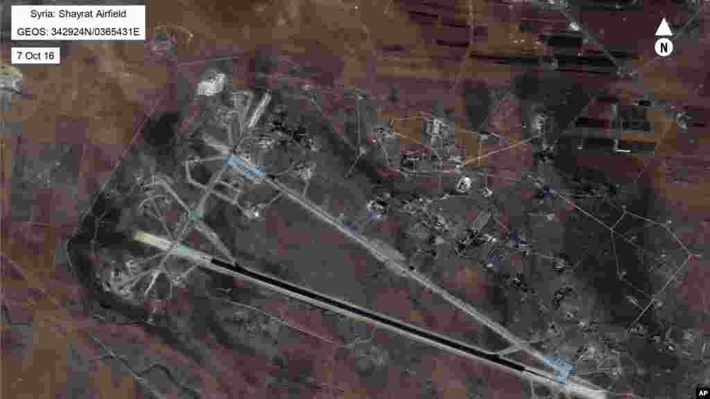 This Oct. 7, 2016 satellite image released by the U.S. Department of Defense shows Shayrat air base in Syria. The U.S. blasted a Syrian air base with a barrage of cruise missiles on April 7, 2017 in fiery retaliation for this week's gruesome chemical weap