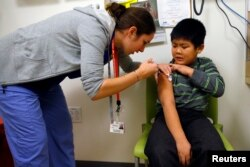 Вакцинація від сезонного грипу, Бостон, 2013, Reuters