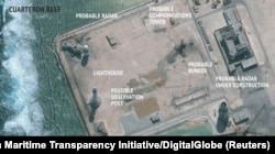 An undated satellite image released by the Asian Maritime Transparency Initiative at Washington's Center for Strategic and International Studies shows construction of possible radar tower facilities in the Spratly Islands in the disputed South China Sea.