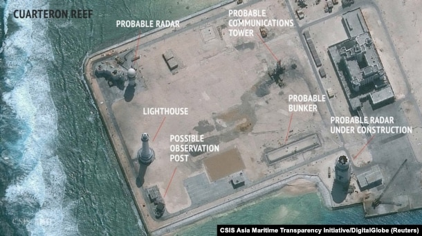 A satellite image released by the Asian Maritime Transparency Initiative at Washington's Center for Strategic and International Studies shows construction of possible radar tower facilities in the Spratly Islands in the disputed South China Sea in this image released on Feb. 23, 2016.
