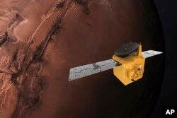 """Model komputer gambar wahana antariksa """"Al Amal"""" yang dilaporkan berhasil memasuki orbit Mars (9/2)."""