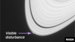 Saturn, with notation showing location of visible disturbance on outer rings. (NASA)