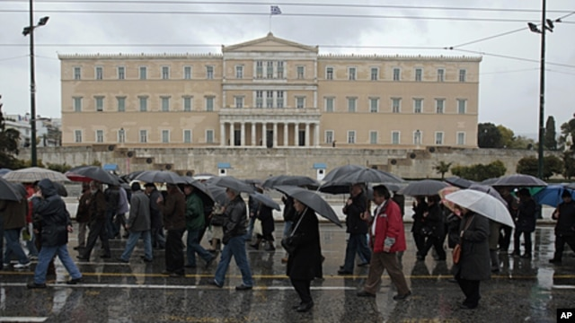 Pensioners march during an anti-austerity rally in front of the parliament in Athens, Greece, February 22, 2012.