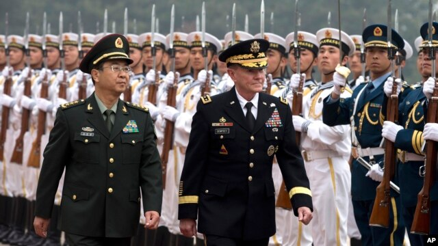 Joint Chiefs Chairman Gen. Martin Dempsey, right, and Chinese counterpart Gen. Fang Fenghui inspect a guard of honor during a welcoming ceremony at the Bayi Building in Beijing, China, April 22, 2013.