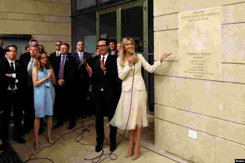 U.S President's daughter Ivanka Trump unveils an inauguration plaque as U.S. Treasury Secretary Steven Mnuchin claps during the opeing of the U.S. embassy in Jerusalem.