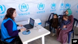 Syrian refugee Bushra, 19, registers at the UNHCR center in the northern city of Tripoli, Lebanon, March 6, 2013.