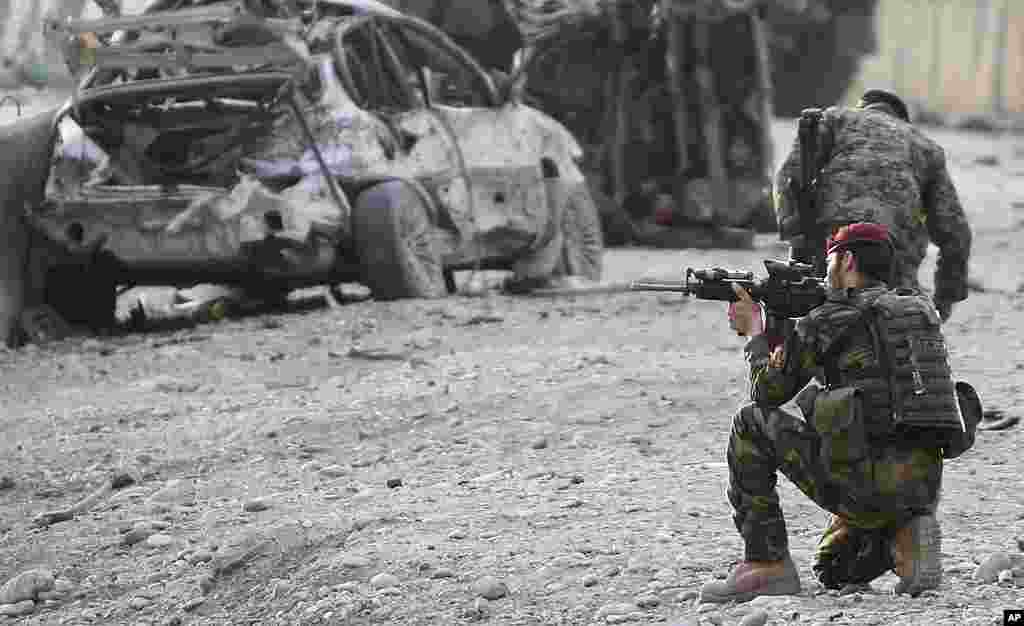 An Afghan soldier at the scene of a suicide attack at the gate of an airport in Jalalabad, Nangarhar province on February 27, 2012. (AP)