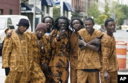 Members of Sierra Leone's Refugee All-Stars, from left, Black Nature, Reuben Koroma, Jah Sun, Ashade Pearce, Malam, Nico and Makengo, are photographed in New York, Oct. 24, 2006.