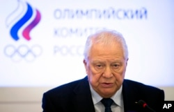 Vitaly Smirnov, a former IOC member from Russia who runs a government-backed anti-doping commission, speaks to journalists after a Russian Olympic committee meeting in Moscow, Russia, Dec. 12, 2017.