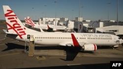 Pesawat milik maskapai penerbangan Virgin Australia terlihat di bandara Sydney, 5 Agustus 2020.