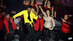 FILE - This July 6, 2013 file photo shows Bollywood actors Sridevi and Prabhu Deva, left in yellow, performing during the International Indian Film Academy (IIFA) awards in Macau.