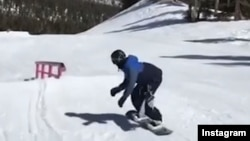 Snowboarder Brolin Mawejje trains in Utah in this undated image taken from a video on his Instagram account.