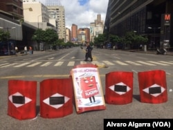 "A street is blockaded during a strike in Caracas, Venezuela, July 26, 2017. The sign reads ""fraudulent."""