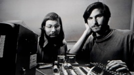 Apple co-founders Steve Jobs and Steve Wozniak are seen working together in this undated photo.