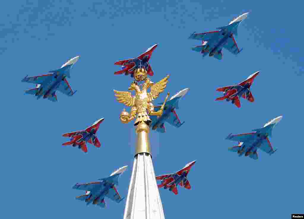 Russian army MiG-29 jet fighters of the Strizhi (Swifts) and Su-30 jet fighters of the Russkiye Vityazi (Russian Knights) aerobatic teams fly in formation during the Victory Day parade, marking the 73rd anniversary of the victory over Nazi Germany in World War II, in central Moscow, Russia.