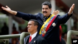 Venezuela's President Nicolas Maduro holds out his arms as arrives to attend a military parade commemorating the country's Independence Day in Caracas, Venezuela, July 5, 2017.