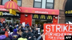 A coalition of groups rally in front of a McDonald's on East 125th Street and Lexington Avenue in Harlem during a protest by fast food workers and supporters for higher wages in New York, Apr. 4, 2013.