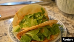 Chicken tacos made by Clint Parry are seen in Auburn Hills, Michigan, U.S., July 30, 2020. Picture taken July 30, 2020. Amanda Parry/Handout via REUTERS