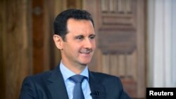 Syria's President Bashar al-Assad answers questions during an interview with al-Manar's journalist Amro Nassef, in Damascus, Syria, in this photograph handed out by Syria's national news agency SANA on Aug. 25, 2015.