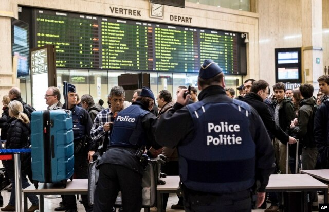 Police search passenger bags at the Central Station in Brussels, March 23, 2016.