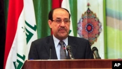 Iraqi Prime Minister Nouri al-Maliki speaks during Convergence of religions conference in Baghdad, Iraq, Saturday, April 27, 2013.