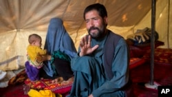 Mohammad Azam, father of Zahra, 14, who died after she was set on fire in her husband's home, talks during an interview in a tent in Kabul, Afghanistan, July 18, 2016.