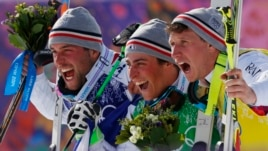 Men's ski cross gold medalist Jean Frederic Chapuis of France, center, celebrates with silver medalist Arnaud Bovolenta of France, left, and bronze medalist Jonathan Midol of France, at the Rosa Khutor Extreme Park, at the 2014 Winter Olympics, Thursday,