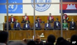 """FILE - Judges arrive at the Extraordinary Chambers in the Courts of Cambodia in Phnom Penh, Cambodia, as the trial for former Khmer Rouge prison commander Kaing Guek Eav, also know as """"Duch"""" begins Tuesday, Feb. 17, 2009, in Phnom Penh, Cambodia."""