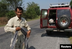 FILE - Chut Wutty, Director of the Natural Resource Protection Group, walks in Koh Kong province, Feb. 20, 2012. The prominent anti-logging activist, who helped expose a secretive state sell-off of national parks, was fatally shot on April 25, 2012 in a remote southwestern province, said police.