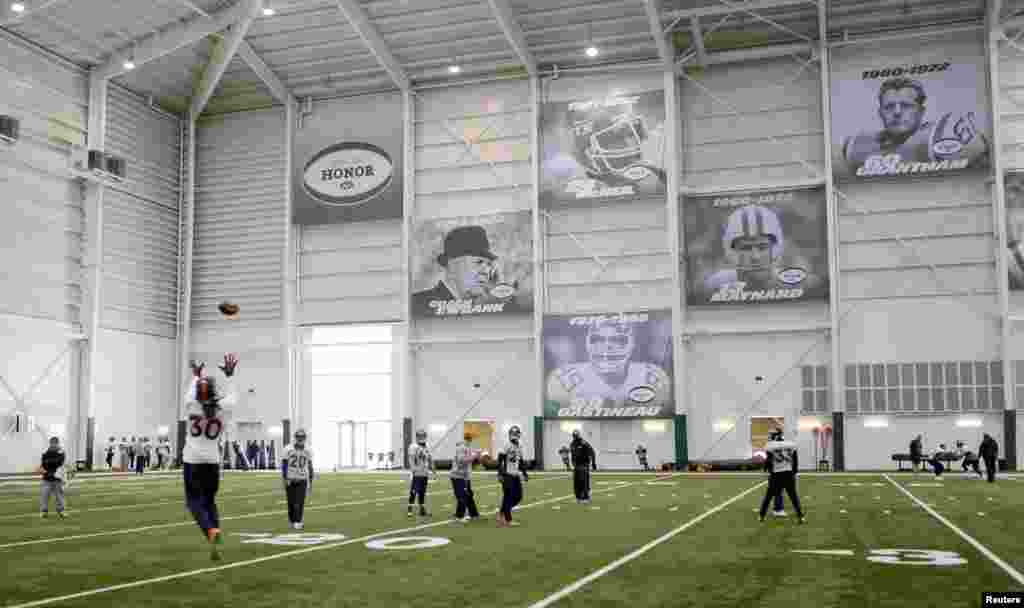 Denver Broncos strong safety David Bruton runs an interception drill during an indoor practice session for the Super Bowl at the New York Jets Training Center in Florham Park, New Jersey, Jan. 30, 2014.