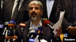 Hamas' leader in exile Khaled Meshaal speaks during a news conference about a cease-fire agreement between Israel and Gaza in Cairo November 21, 2012.