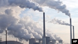 FILE - Steam and smoke is seen over the coal burning power plant in Gelsenkirchen, Germany.