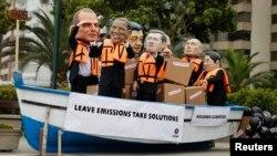 Activists, demanding cuts in global emissions, wear masks depicting, from left: Australia's Prime Minister Tony Abbot, U.S. President Barack Obama, China's President Xi Jinping, Canada's Prime Minister Stephen Harper, India's Prime Minister Narendra Modi,
