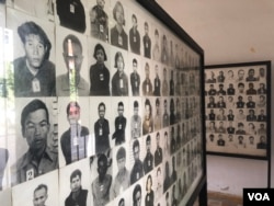 Photos of prisoners during the Khmer Rouge regime, displayed at the Tuol Sleng Genocide Museum in Phnom Penh, Cambodia. (Sun Narin/VOA Khmer)