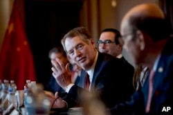 FILE - U.S. Trade Representative Robert Lighthizer, accompanied by Trump administration officials, speaks during a meeting with Chinese Vice Premier Liu He and other Chinese officials on the White House Complex, Jan. 30, 2019.