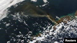 FILE - A plume of smoke from Alaska's Pavlof volcano is pictured in this Nov. 14, 2014 NASA handout satellite image.