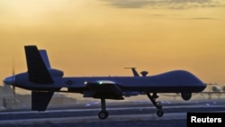 FILE - A MQ-9 Reaper drone taxis at Kandahar Airfield, Afghanistan in this Dec. 27, 2009 photo.