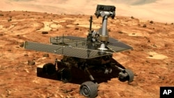 FILE - This illustration made available by NASA shows the rover Opportunity on the surface of Mars. The exploratory vehicle landed on Jan. 24, 2004 and finally fell silent during a dust storm in June 2018.