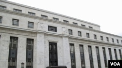 FILE - Federal Reserve building in Washington.