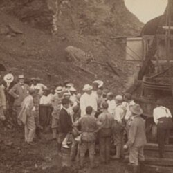 President Roosevelt, center, discussing America's task with workmen at Bas Obispo on the Panama Canal in 1906