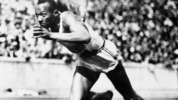 Jesse Owens competes in one of the heats of the 200-meter run at the 1936 Olympic Games in Berlin.