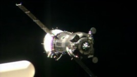 In this image taken from video provided by NASA, the Soyuz TMA-09M carrying three new Expedition 36 crew members approaches the International Space Station, May 29, 2013.