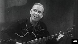 美国乡村音乐歌手欧冯.金.奥崔演唱《哦,苏珊娜!》,1936年。